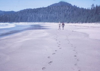 Jack Mercer and Hank Grant walking the sandy beach at Raft Cove