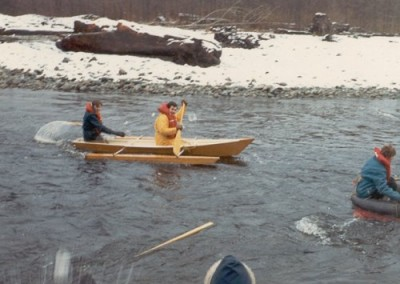 Klondike Days_ Kids throwing snowballs at competitors in boat race
