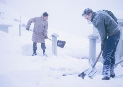 Personnel shovelling snow from the DMCC roof - January 1965