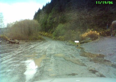 A clearer view of the old Winter Harbour road, with the rusty tank off to the right. The new one now passes by the location of the old CFS Holberg.